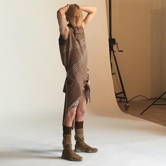 Model- Benjamin Irmov poses backstage at the show