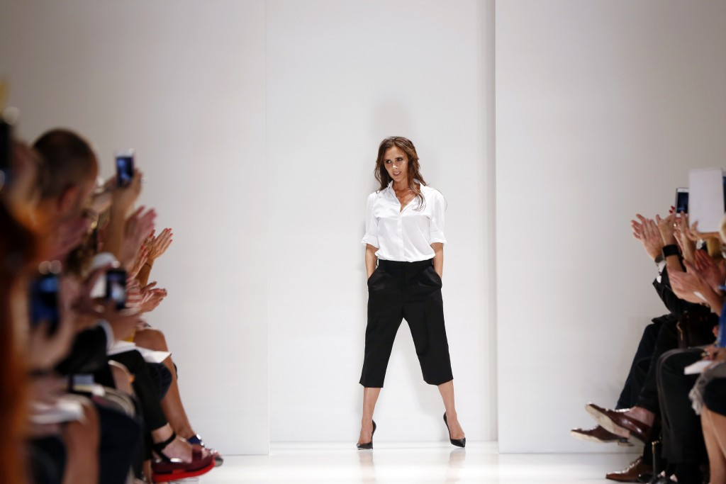 Designer Victoria Beckham acknowledges the audience after presenting her Spring/Summer 2014 collection during New York Fashion Week, September 8, 2013. REUTERS/Lucas Jackson (UNITED STATES - Tags: FASHION)
