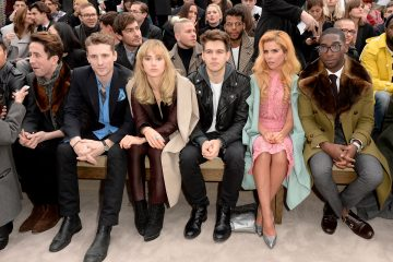 sit in the front row during the Burberry AW14 Menswear Show at Kensington Gardens on January 8, 2014 in London, England.
