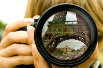 Eiffel tower reflection in camera lenses